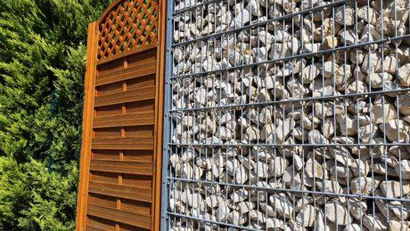 Różne rodzaje ogrodzeń: gabionowe, metalowe i żywopłot